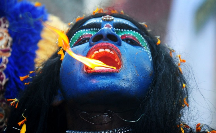 An Indian artist dressed as the Hindu goddess Kali participates in a procession to celebrate the Ram Navami festival in Allahabad on April 8, 2014. Hindu devotees celebrate the festival of Ram Navami, the birth anniversary of Lord Rama, across India, which also marks the end of the nine-day long fasting and Navaratri festival. (Sanjay Kanojia/AFP/Getty Images)