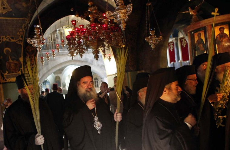 Greek Orthodox priests carry palm branches during the Palm Sunday celebrations at the Church of the Holy Sepulchre in Jerusalem's Old City on April 13, 2014. The ceremony is a landmark in the Christian calendar, marking the triumphant return of Christ to Jerusalem the week before his death, when a cheering crowd greeted him waving palm leaves.(Thomas Coex/AFP/Getty Images)