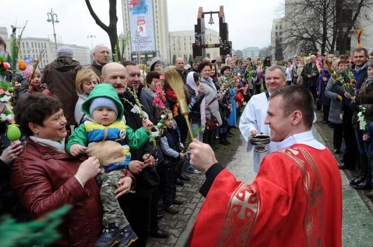 A Belarusian catholic priest blesses believers with holy water while celebrating Palm Sunday in Minsk on April 13, 2014. (Viktor Drachev/AFP/Getty Images)