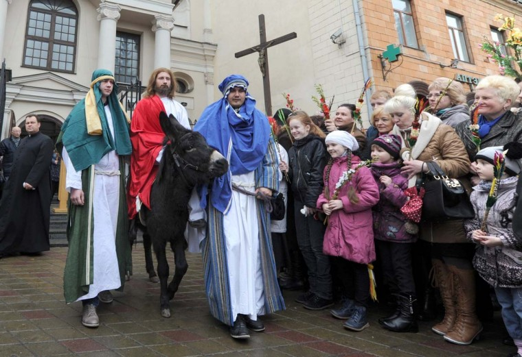 Belarusian catholic believers watch a religious procession while celebrating Palm Sunday in Minsk on April 13, 2014. (Viktor Drachev/AFP/Getty Images)