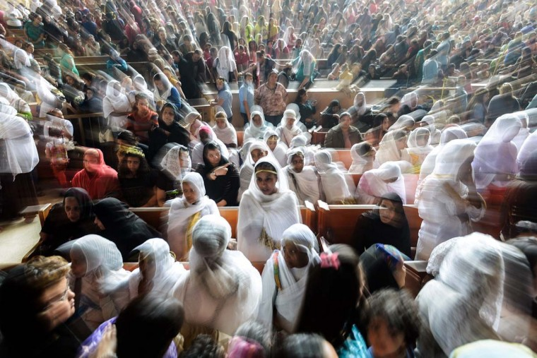 Orthodox Christians attend the Palm Sunday service on April 13, 2014 in Cairo, to celebrate the triumphant return of Jesus Christ to Jerusalem when a cheering crowd greeted him waving palm leaves the week before his death. (Mohamed El-Shahed/AFP/Getty Images)