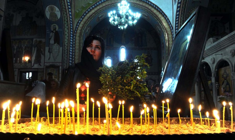 An Georgian Orthodox believer holds pussy-willow branches to mark the celebration of Palm Sunday in a cathedral in the Georgia's capital Tbilisi, on April 13, 2014. (Viktor Drachevvano Shlamov/AFP/Getty Images)