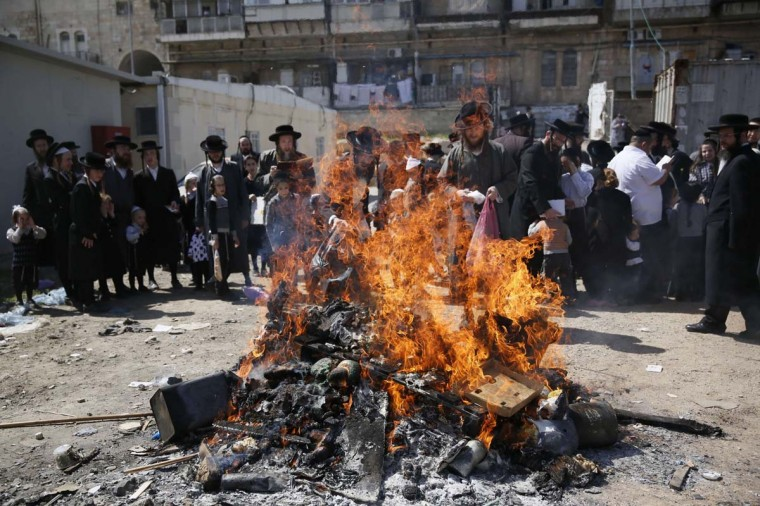 Ultra-Orthodox Jews burn leavened items in a final preparation before the start at sundown of the Jewish Pesach (Passover) holiday, on April 14, 2014 in Jerusalem. Religious Jews worldwide eat matzoth during the eight-day Pesach holiday that commemorates the Israelis' exodus from Egypt some 3,500 years ago and their ancestors' plight by refraining from eating leavened food products. (Gali Tibbon/AFP/Getty Images)