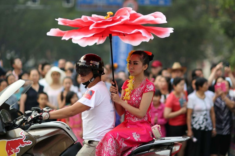 A woman takes part in a parade to celebrate the Dai ethnic group new year in Jinghong, southwest China's Yunnan province on April 14, 2014. A series of celebrations kick off on April 13 to welcome the coming year of 1376 in the Dai ethnic group calendar, with people dancing and parading on the streets of Jinghong municipality in China's Xishuangbanna Dai Autonomous Prefecture. (AFP/Getty Images)