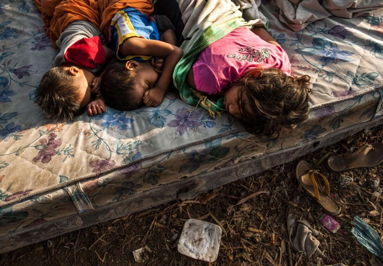 Children sleep on a mattress in the open sky in Managua on April 14, 2014, as tremors have not stopped in Nicaragua since April 10 when a 6.2-magnitude earthquake hit the country's Pacific region. The quakes that struck Nicaragua in the past days killed one person, left 40 injured and damaged more than two thousand homes, according to official sources. (Into Ocon/AFP/Getty Images)
