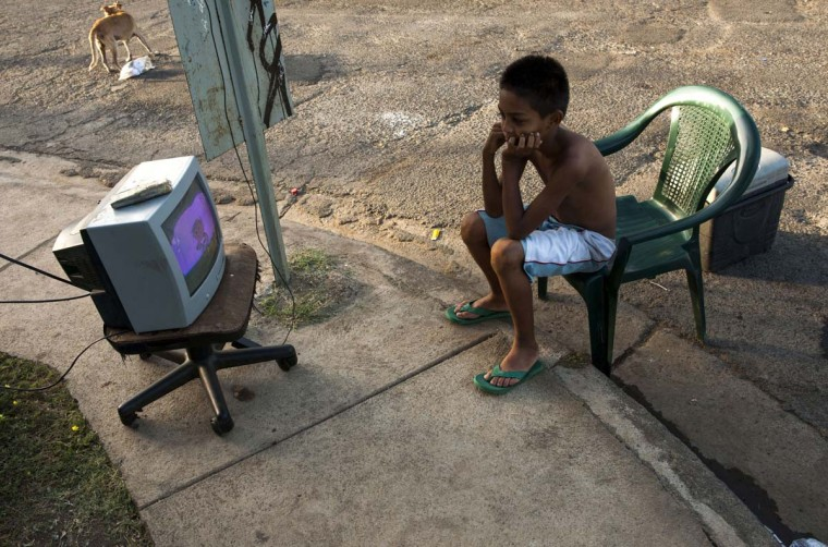 A boy watches TV on a street in Managua on April 14, 2014, as tremors have not stopped in Nicaragua since April 10 when a 6.2-magnitude earthquake hit the country's Pacific region. The quakes that struck Nicaragua in the past days killed one person, left 40 injured and damaged more than two thousand homes, according to official sources. (Inti Ocon/AFP/Getty Images)