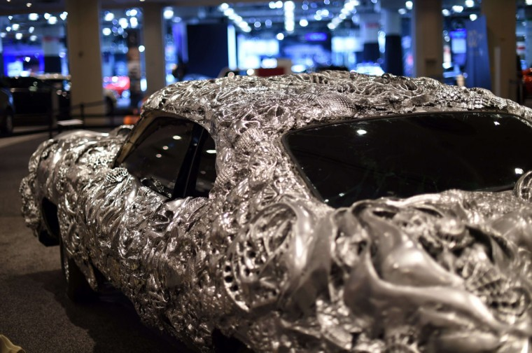 Artist Ioan Florea transformed the iconic muscle car, a Gran Torino, into a 3D piece of art by covering the car in a new metal surface with printed appliques is seen during the second press preview day at the 2014 New York International Auto Show April 17, 2014 at the Jacob Javits Center in New York. (Timothy A. Clary/AFP/Getty Images)