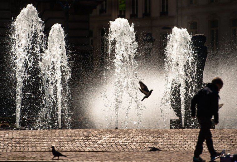 A man walks in front of a fountain in the center of Lille, on April 17, 2014. (Philippe HuguenAFP/Getty Images)