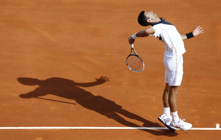 Serbia's Novak Djokovic serves to Spain's Pablo Carreno Busta during their Monte-Carlo ATP Masters Series Tournament tennis match, on April 17, 2014 in Monaco. (Valery Hache/AFP/Getty Images)