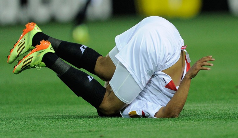 Sevilla's Colombian forward Carlos Bacca falls during the UEFA Europa League semifinal first leg football match Sevilla FC vs Valencia CF at the Ramon Sanchez Pizjuan stadium in Sevilla on April 24, 2014. (Jose Jordan/AFP/Getty Images)