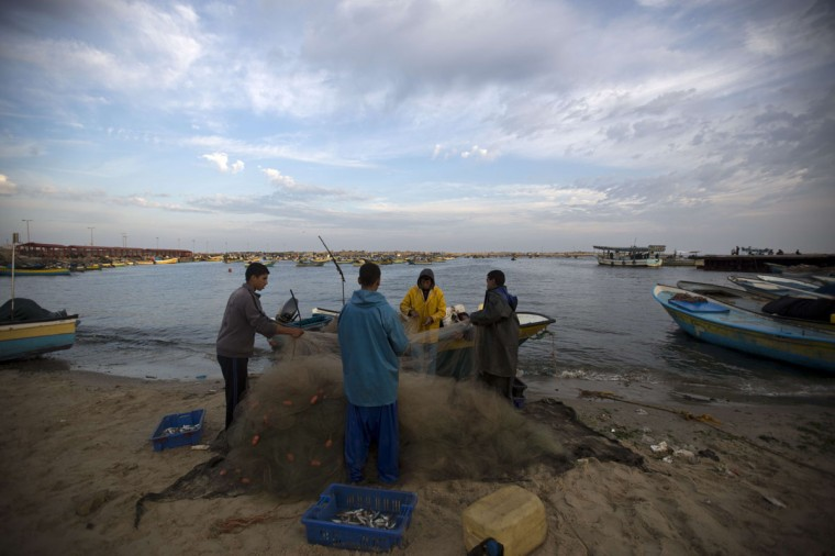 Palestinian fishermen prepare their fishing net at the harbour in Gaza City on April 25, 2014. Israel said it was halting negotiations with the Palestinians following their unity deal with the Hamas rulers of Gaza, as faltering US-backed peace talks approached their deadline. (Mohammed Abed/AFP/Getty Images)