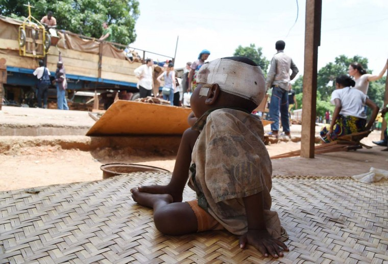 A child wearing a bandage around his head sits as a vehicle loaded with people and goods, part of a convoy of vehicles carrying Muslims from the PK12 district, outside of Bangui, gets ready to leave the city on April 27, 2014. About 1,300 Muslims who were hiding on the outskirts of Bangui, and were frequently attacked by predominantly Christian militias, left Bangui on Sunday in an impressive convoy escorted by the Misca African force, to relocate north of the country. (Issouf Sanogo/AFP/Getty Images)