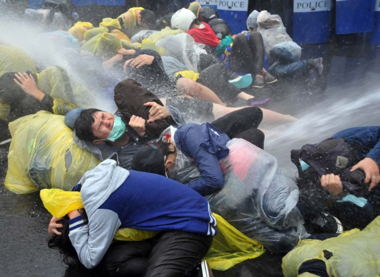 Taiwan police fire water cannon at protesters squatting on the ground outside Taipei Railway Station during an anti-nuclear demonstration in Taipei on April 28, 2014. Police used water cannon to dislodge hundreds of activists on April 28 occupying a busy street overnight in protest against a controversial nuclear power plant, after the government said it would halt the project. Mandy Cheng/AFP/Getty Images)