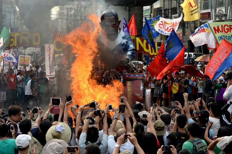 Protesters burn a US President Barack Obama effigy during an anti-US protest near Malacanang palace in Manila on April 28, 2014. Acitivists welcome Obama with huge protest. Obama landed in the Philippines on April 28 to cement new defence ties on the last leg of an Asian tour conducted against a backdrop of territorial tensions between US allies and China. (Noel Celis/AFP/Getty Images)