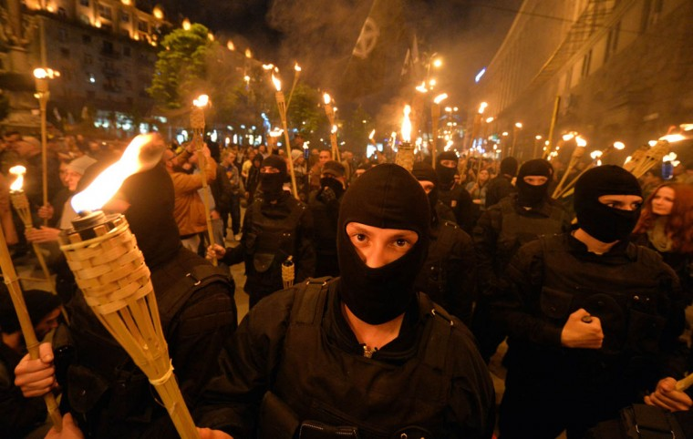 """Unknown ultra-nationalists activists march towards the Independence Square to commemorate """"Maidan heroes"""" in Kiev. Sergei Supinsky/Getty Images)"""