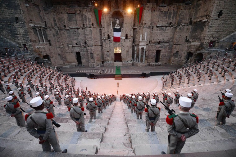 Soldiers of the 1st Foreign Cavalry Regiment of the French Foreign Legion stand guard during the rehearsal of the ceremony marking the commemoration of the battle of Camaron, which occurred on 30 April 1863 between the French Foreign Legion and the Mexican army, on April 29, 2014 in the ancient theatre of Orange. The ceremony will mark the regiment's last public appearance in Orange before its move to its new base in Carpiagne. (Boris Horvat/Getty Images)