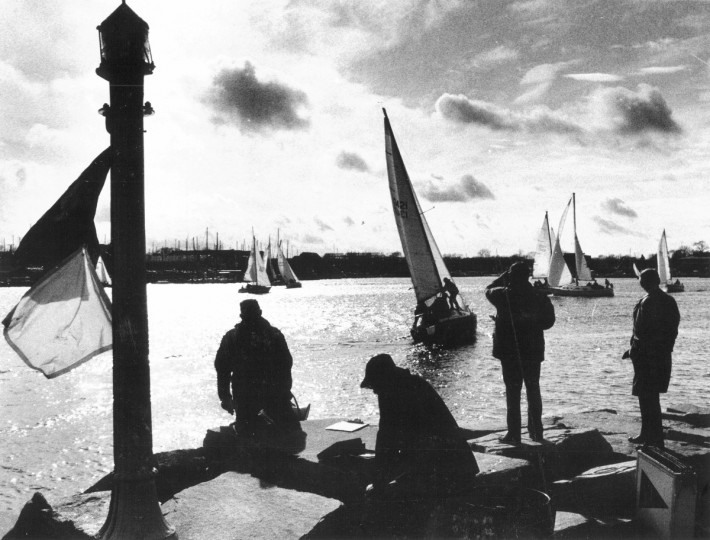 In January 1982, contestants in the Rainbow class of the annual Hangover Bowl J sailboat race jockeyed for a good starting position at the Annapolis Yacht Club. The frostbitten sailors had their hands full as they competed with gusting winds in the Chesapeake Bay after setting out from the yacht club. (Lloyd Pearson/Baltimore Sun)