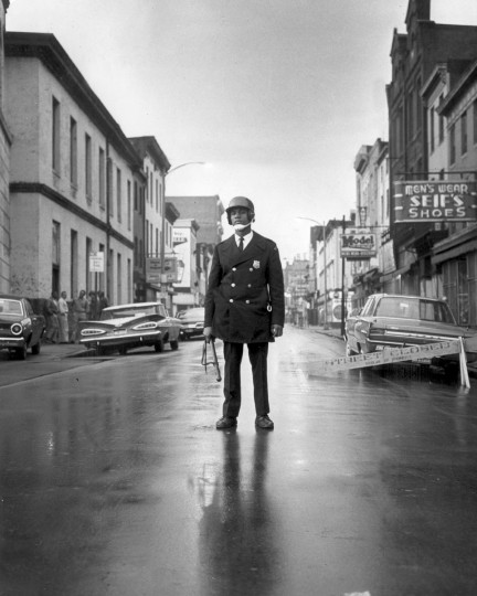 A policeman blocks traffic at Gay and Orleans Streets during the April 1968 riots that followed the assassination of Dr. Martin Luther King, Jr. The riots lasted from April 6-14. (Lloyd Pearson/Baltimore Sun)