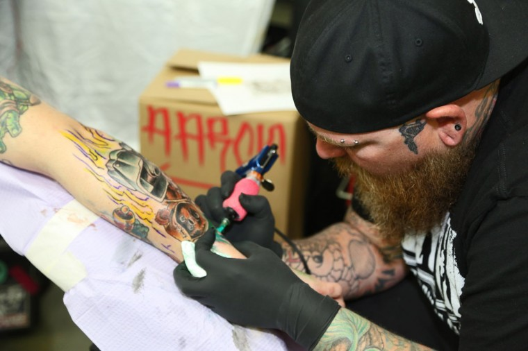 Zach Paxson, 25, of Tampa, Flordia gets tattooed by Frank Cabbageat the Baltimore Tattoo Convention this past weekend. Over one hundred tattoo artists came from around the country to participate in the annual event. (Kaitlin Newman/Baltimore Sun)