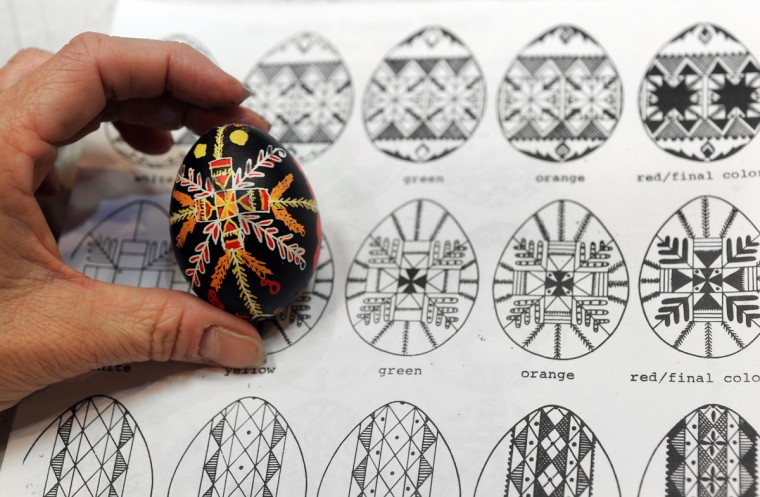 Maura Taylor copied the designs on the paper when she decorated her egg. (Algerina Perna/Baltimore Sun)