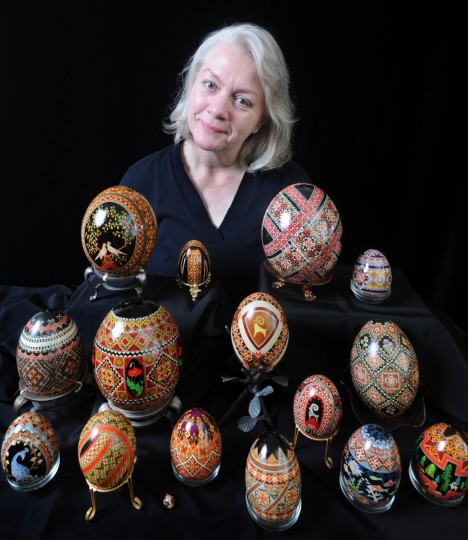 Halyna Mudryj is pictured in her home with some of her collection of pysanky - intricately decorated Ukrainian eggs with symbols - which she decorated. (Algerina Perna/Baltimore Sun)