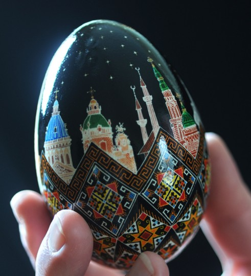 "Halyna Mudryj made this egg ""in honor of all the people that died in this recent ongoing revolution in Ukraine. They refer to them as the 'heavenly battalion.' The stars on the egg represent the 100 or so people that were killed. The churches on the egg represent definite churches that exist in Ukraine from north to south, east to west."" She included mosques, churches and temples. The building with the two narrowest spires is the Muslim Mosque. (Algerina Perna/Baltimore Sun)"