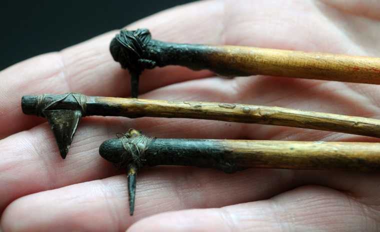 """My grandfather made the stylus (in center) by unwinding the metal tips that held shoelaces together, & somehow attached it to a little stick or branch with wire."" Wax was poured into the stylus and used to write with wax. (Algerina Perna/Baltimore Sun)"