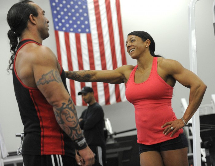 David Johnston and his wife Nikki enjoy a light moment between exercises at a gym in Columbia. (Lloyd Fox/Baltimore Sun)