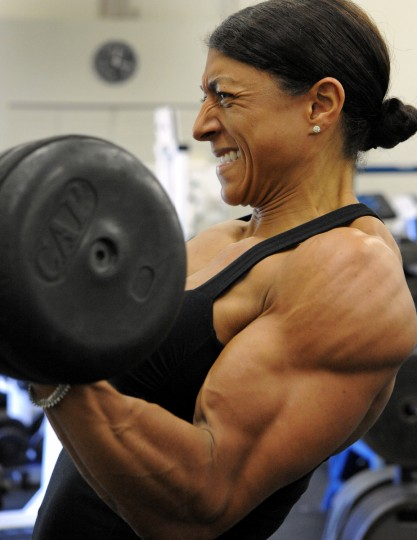 Columbia bodybuilder Nikki Johnston does arm curl repetitions with free weights at the Colosseum Gym. (Lloyd Fox/Baltimore Sun)