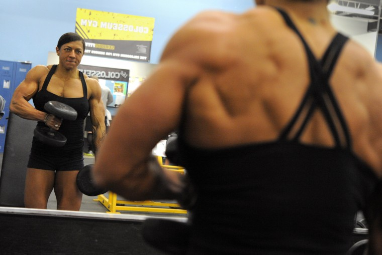 Nikki Johnston works with free weights as she exercises at the Colosseum Gym. (Lloyd Fox/Baltimore Sun)