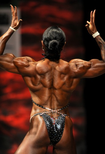 Nikki Johnston poses at the 2014 NPC Baltimore Gladiator Championships. She won the Women's Physique division tall class and the overall as well. (Lloyd Fox/Baltimore Sun)