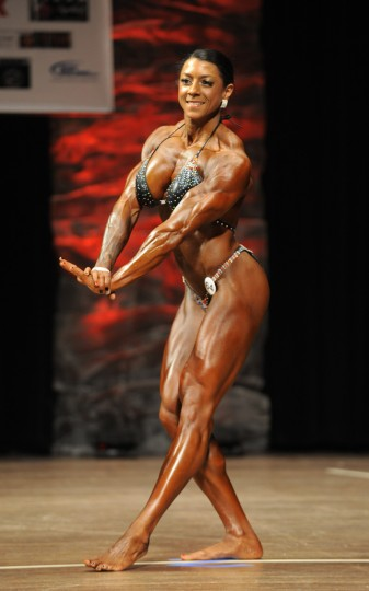 Nikki Johnston strikes a pose during the 2014 NPC Baltimore Gladiator Championships. She won the Women's Physique division tall class and was the overall winner as well. (Lloyd Fox/Baltimore Sun)