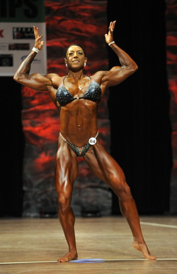 While competing in the 2014 NPC Baltimore Gladiator Championships , Nikki Johnston poses in a number of different positions that will accentuate her muscle tone. She won the women's physique division tall class and the overall as well. (Lloyd Fox/Baltimore Sun)