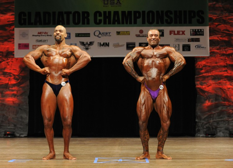 David Johnston, right, poses to show off his physique as he competes in the The 2014 NPC Baltimore Gladiator Championships held at Goucher College. He won the heavyweight division at the competition. (Lloyd Fox/Baltimore Sun)
