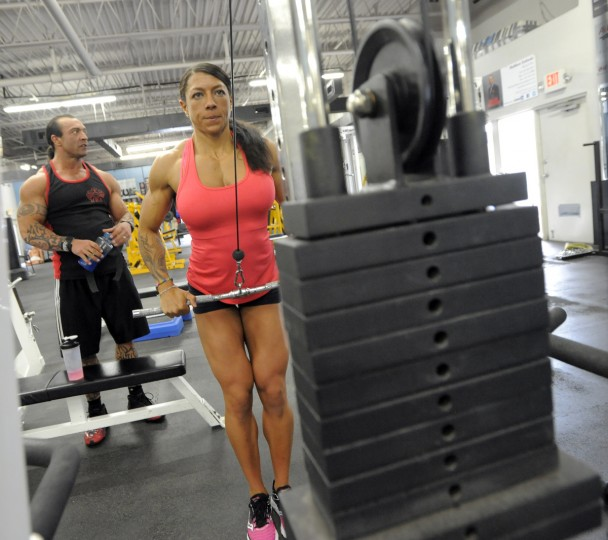 Columbia bodybuilding couple, David and Nikki Johnston, work out at the Colosseum Gym as they prepare for a bodybuilding tournament. (Lloyd Fox/Baltimore Sun)