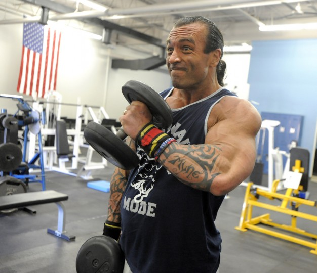 David Johnston does exercises with free weights as he works out at the Colosseum Gym in preparation for and upcoming bodybuilding tournament. (Lloyd Fox/Baltimore Sun)