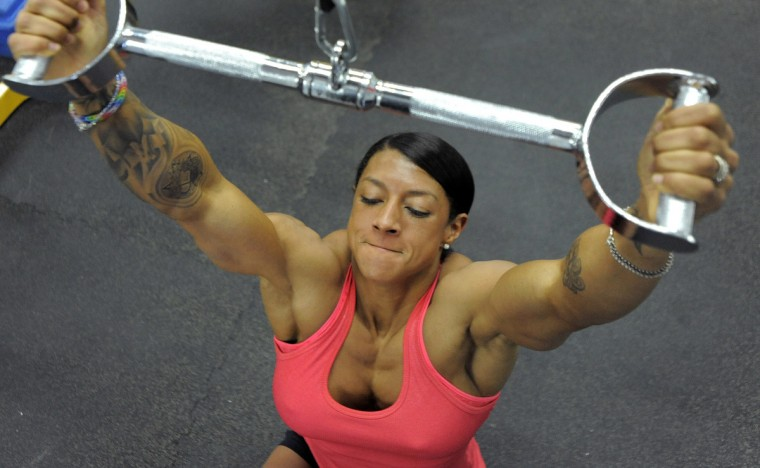 Nikki Johnston lifts weights as she works out in preparation for competition. (Lloyd Fox/Baltimore Sun)
