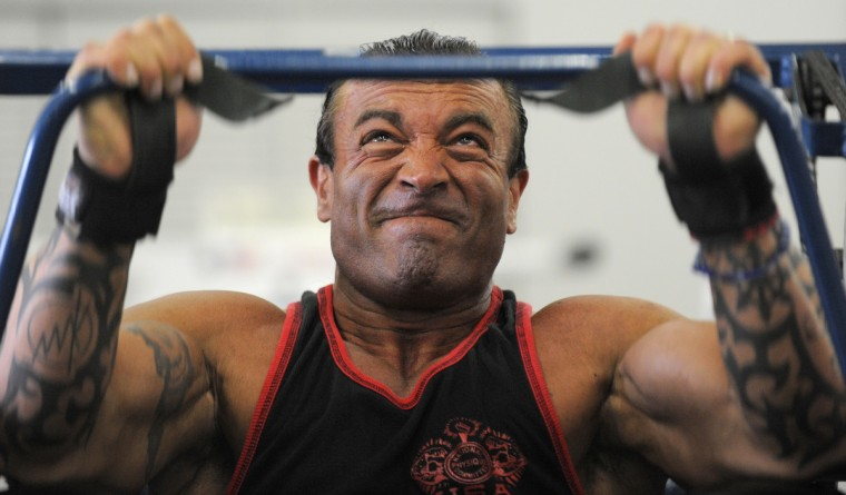 David Johnston grimaces as he does his workout. The Columbia body builder is preparing for an upcoming competition. (Lloyd Fox/Baltimore Sun)