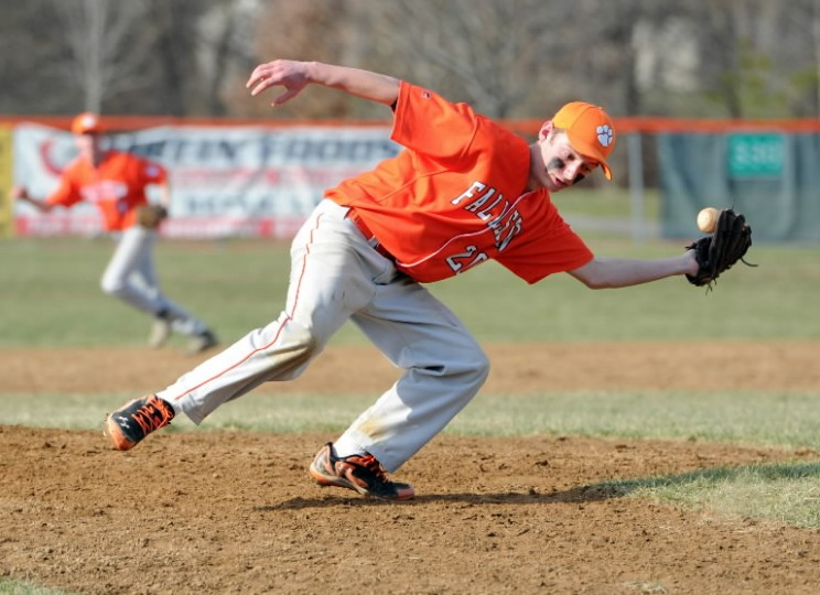 Fallston pitcher Luke Gover stretches to try to make the grab on a ball hit back to him by the Perryville batter during Wednesday's game at Fallston. (Matt Button/BSMG)