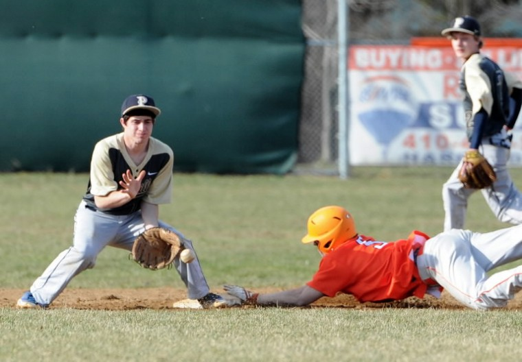Perryville infielder Jacob Hudson sets up to make the catch and try to tag out the sliding Fallston runner Erik Dettloff during Wednesday's game at Fallston. (Matt Button/BSMG)