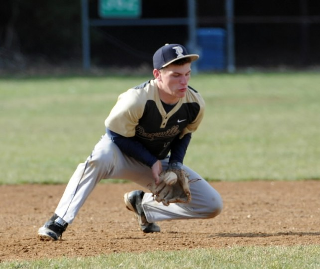 Perryville third baseman Dustin Krahn knocks down a bouncing infield hit during Wednesday's game at Fallston. (Matt Button/BSMG)