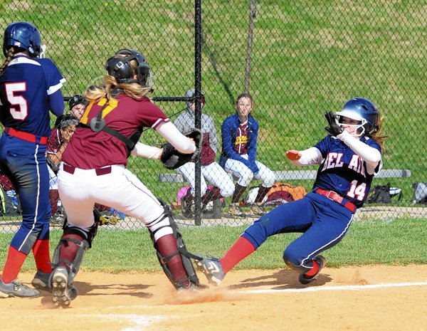 Bel Air's Brianna Fleishmann prepares for a collision with Havre de Grace catcher Emily Lewis as she slides into home during a softball game Wednesday, April 23, in Bel Air. (Matt Button/BSMG)
