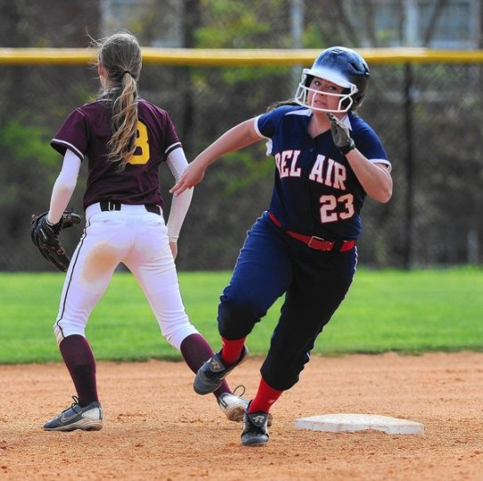 Bel Air's Taylor Hensley rounds second and is determined to reach third as Havre de Grace infielder Rebecca Ashman waits for the relay throw during an April 23 game at Bel Air. (Matt Button/BSMG)