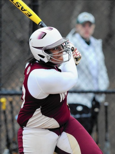 Havre de Grace's Taylor Smith watches her hit sail into the outfield for a home run during a softball game at North Harford Friday, April 4. (Matt Button/BSMG)
