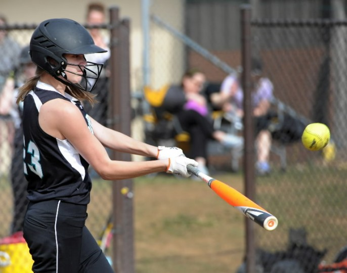 Patterson Mill batter Lauren Rossi makes contact and puts the ball into play during an at bat in Wednesday's game at Fallston. (Matt Button/BSMG)