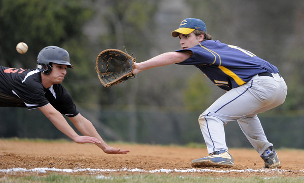 Catonsville first baseman Jake Smuck catches a pickoff throw, but Tech's Andrew Pikounis was safe during the second inning of Eastern Tech's 5-2 win. Smuck was 3-for-3. (Lloyd Fox/Baltimore Sun)