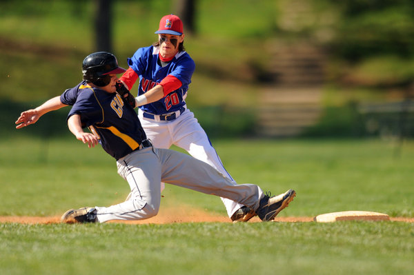 Catonsville's Jake Smuck is tagged out trying to get back to second base by Lansdowne shortstop Shane Chaffman on a fielders choice play during a baseball game at Catonsville High School on Thursday, April 24. (Brian Krista/BSMG)