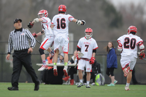 Glenelg's Tyler Wasson (16) celebrates a second quarter goal with teammate Zach Bailey during a boys lacrosse game against River Hill at Western Regional Park on Friday, April 4. (Brian Krista/BSMG)