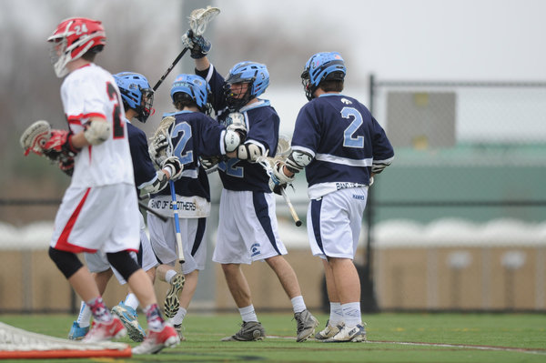 River Hill's Jake Friedman, second from right, celebrates a goal with teammates during a boys lacrosse game against Glenelg at Western Regional Park on Friday, April 4.
