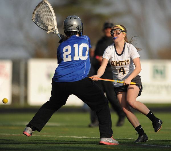 Catonsville's Anderson Gill fires a shot past Sparrows Point goalie Keira Lane during a girls lacrosse game at Catonsville High School on Wednesday, April 23. (Brian Krista/BSMG)
